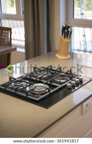 Gas stove in modern kitchen - stock photo