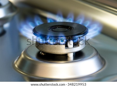 Gas stove with flames of burning gas, gas burner photo - stock photo
