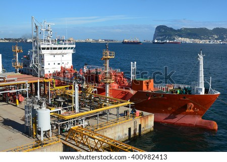 Gas tanker is loading in the port - stock photo