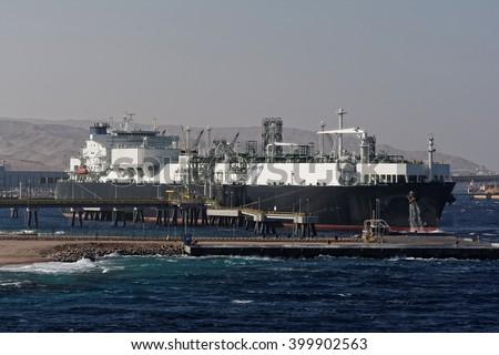 Gas tanker loading in port - stock photo