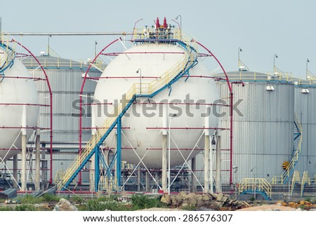 Gas tanks for petrochemical plant - stock photo