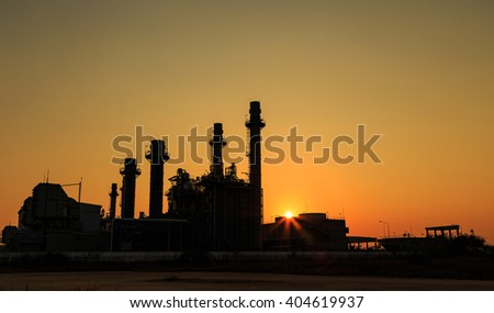 Gas turbine electrical power plant with sunset  at dusk - stock photo