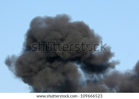 Gasoline and Dynamite Explosion with Billowing Black Smoke - stock photo