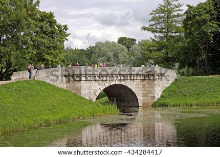 Gatchina, Russia - 29 July 2015: Karpin bridge in the Gatchina Palace Park. Built in the 18th century - stock photo