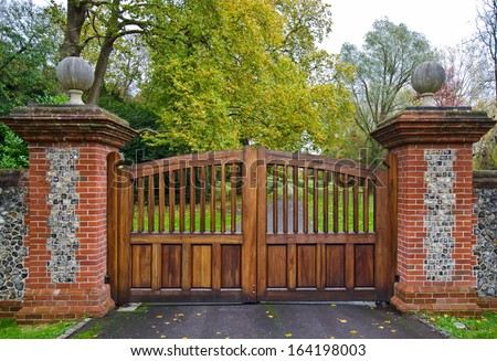 Gate and Driveway of a Country Mansion - stock photo
