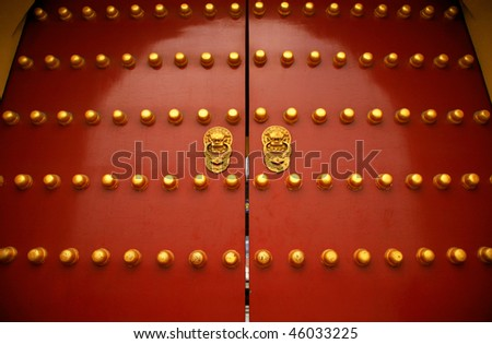 "Gate of the Forbidden City in Beijing. The big ""gold buttons"" are doornails. - stock photo"