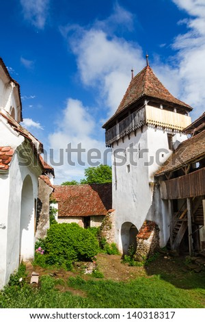 Gate Tower of Viscri fortified church, medieval saxon fortification of Transylvania, Romania. - stock photo