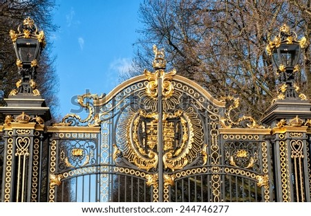 Gate with gilded ornaments in Buckingham Palace. Buckingham Palace is a symbol and home of the British monarchy. - stock photo