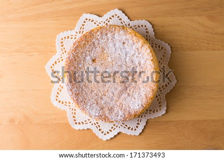 Gateau au chocolat blanc is a French cake made of white chocolate, butter, eggs, sugar, heavy cream, cognac liqueur, and vanilla pods' seeds; frosted with powdered sugar  - stock photo