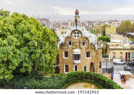 Gatehouse at the main entrance to Park Guel, which were originally designed as the caretaker�s house. Barcelona, Spain. Park Guell (1914) is the famous architectural town art designed by Antoni Gaudi. - stock photo