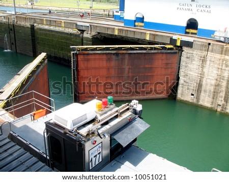 Gates opening in the Gatun Locks of the Panama Canal - stock photo