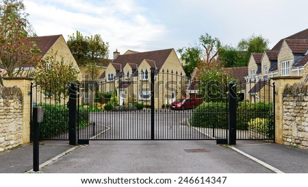 Gateway and Drive of a Gated Community on an Upscale English Residential Housing Estate - stock photo