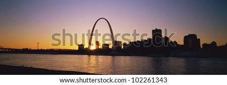 Gateway Arch and St. Louis at dawn - stock photo