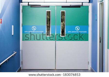 gateway to hospital emergency. across the silhouette of a doctor walking - stock photo