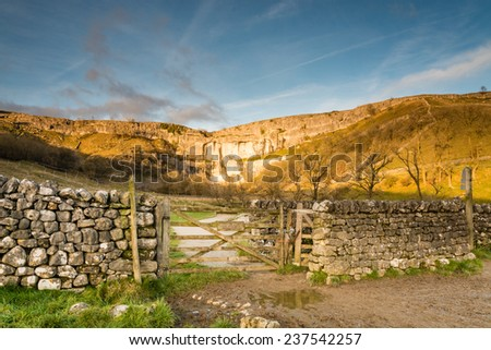 Gateway to Malham Cove / Malham Cove in Malhamdale is a popular tourist attraction of the Yorkshire Dales National Park - stock photo