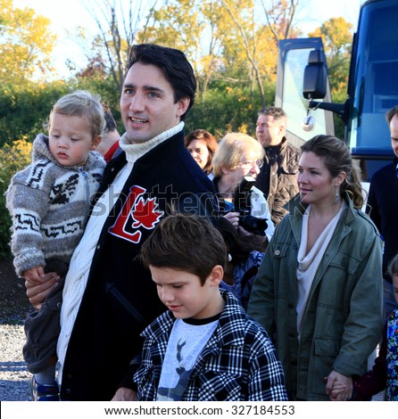 GATINEAU, QUEBEC, CANADA - OCTOBER 13, 2015: Liberal leader Justin Trudeau, wife Sophie Gregoire and sons Hadrien (L) and Xavier (R).  - stock photo