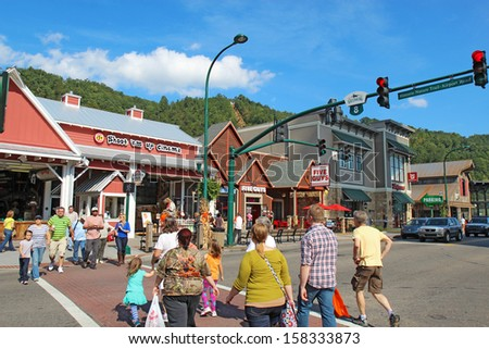 GATLINBURG, TENNESSEE - OCTOBER 6: Tourists and traffic in Gatlinburg, Tennessee on October 6, 2013. Gatlinburg is a major tourist destination and gateway to the Great Smoky Mountains National Park. - stock photo