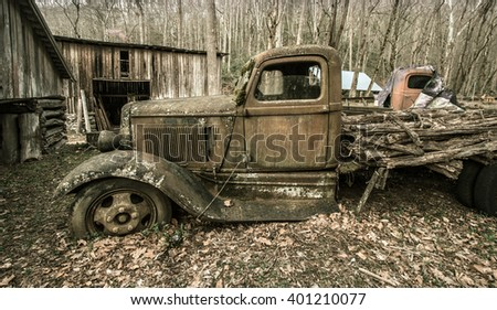 Gatlinburg, Tennessee, USA. March 25, 2016 - A 1930's Dodge pick up truck abandoned on a farm with it's load of logs still in place. - stock photo
