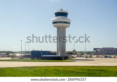 GATWICK AIRPORT, UK - MAY 16, 2015:  The main control tower at London's Gatwick Airport in West Sussex. - stock photo