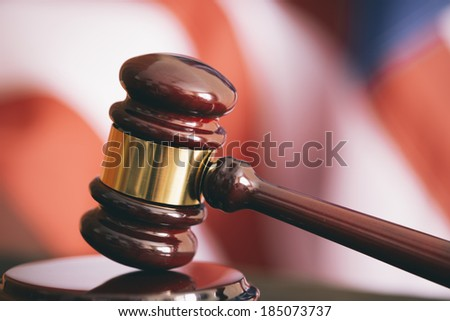 Gavel and american flag, symbol for jurisdiction , selective focus - stock photo