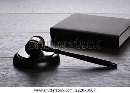 Gavel and book on the table in legal concept - stock photo
