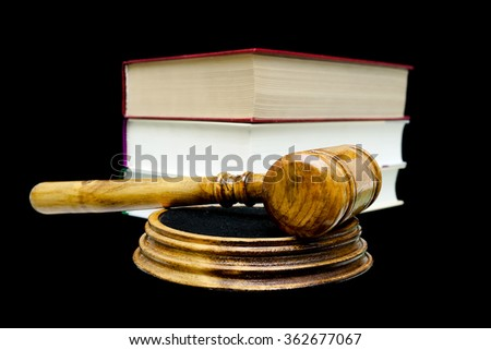 gavel and books isolated on a black background close-up. horizontal photo. - stock photo