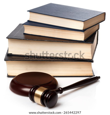 Gavel and books on white background - stock photo