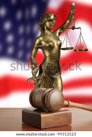 Gavel and Lady of Justice  and USA flag - stock photo