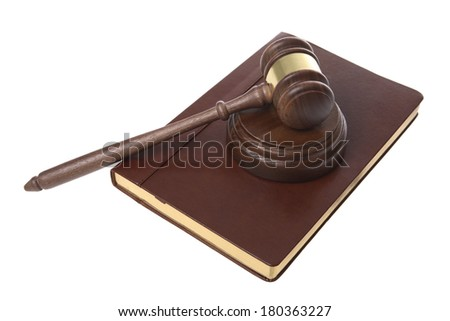 Gavel and leather bound book - stock photo