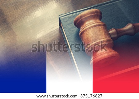 Gavel and legal book on wooden table, collage with flag of france - stock photo