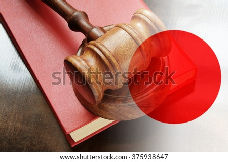 Gavel and legal book on wooden table, collage with flag of japan - stock photo
