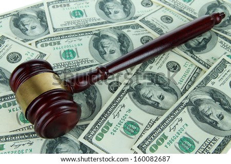 Gavel and money close-up - stock photo