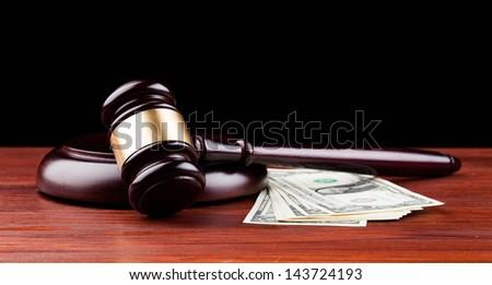 gavel and money isolated on black - stock photo