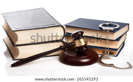 Gavel, books and handcuffs on white background - stock photo