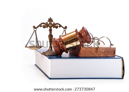 Gavel, bronze scales, glasses judges and law book on a white background - stock photo