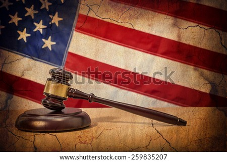 Gavel on a background of the American flag - stock photo