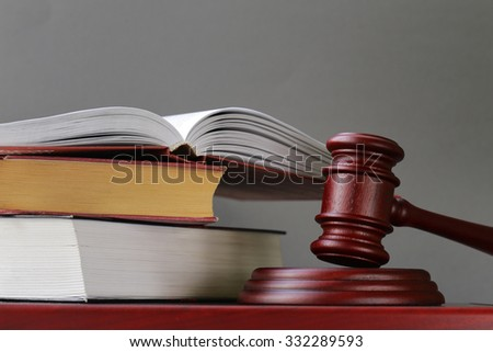 gavel on a stand on a wooden background - stock photo