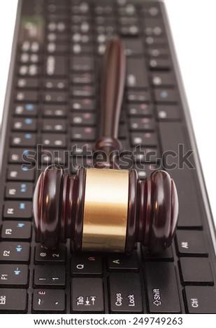 Gavel on computer keyboard - stock photo
