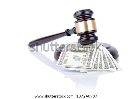 Gavel on 100 dollar bills isolated on white - stock photo