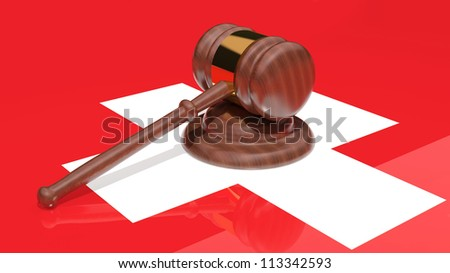 Gavel on the flag of Switzerland - stock photo