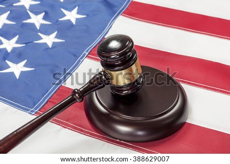 Gavel on the flag of US - stock photo