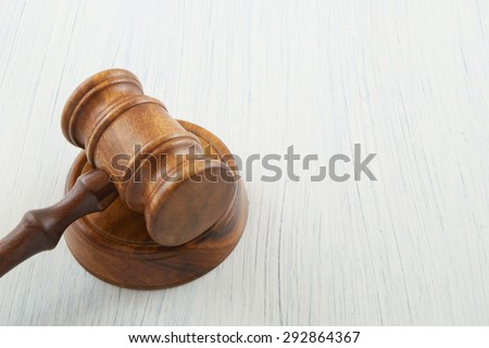 Gavel on white table background with copyspace - stock photo