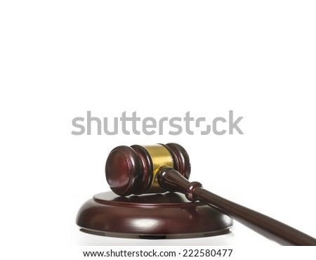 Gavel on wood block isolated against white background - stock photo