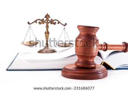 Gavel, open book and bronze scales on a white background - stock photo