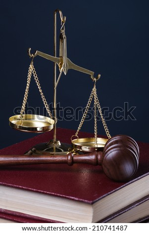gavel, scale and books on blue - stock photo