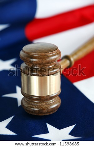 Gavel with flag background - stock photo