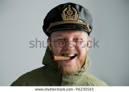 Gay captain Havana cigar in his mouth - stock photo