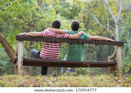 Gay couple enjoying autumn in the park - stock photo
