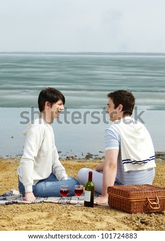 Gay couple having a romantic picnic on a sunny spring day - stock photo