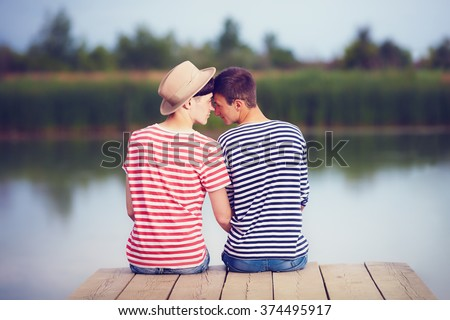 gay couple in love on river bank - stock photo